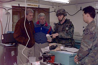 Frank Wolf (politician) - Wolf and then Senator Dan Coats visit the 212th Mobile Army Surgical Hospital at Camp Bedrock in Bosnia-Herzegovina during Operation Joint Endeavor in 1996