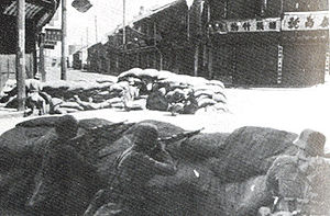 Battle of Shanghai - Soldiers from the 88th Division defending an intersection behind sandbag fortifications