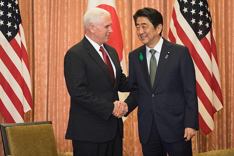 Shinzo Abe and Mike Pence shake hands.jpg