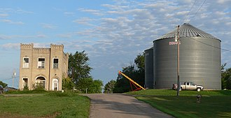 Sholes, Nebraska - Wayne County Bank building and grain bins in Sholes