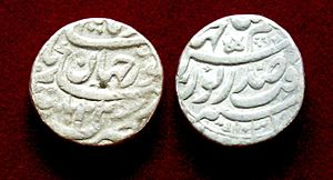 Nur Jahan - Silver rupee coin minted under Jahangir, bearing the name of Nur Jahan. Dated AH 1037, regnal year 22 (1627/1628 CE), minted at Patna.