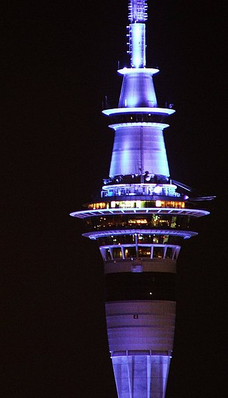 Sky Tower (Auckland) - The upper sections of the Sky Tower, illuminated at night