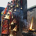 Smoking candles at muktinath temple, nepal.JPG