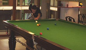 Baize - A baize-covered snooker table.