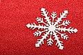 Snowflake on red glittery background.jpg