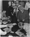 "Social Security ""Unemployed insured workers registering for jobs and filing benefit claims at a State employment... - NARA - 195881.tif"