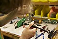 Soldering a theremin circuit, Moog Music factory.jpg