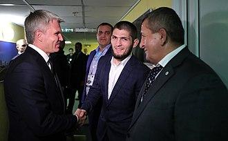 Khabib Nurmagomedov - Sports Minister Pavel Kolobkov, left, congratulated Khabib Nurmagomedov on winning the UFC Championship