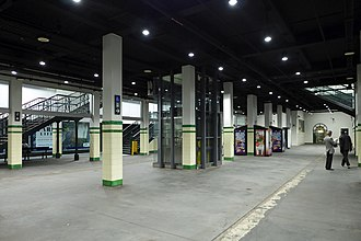 St James railway station, Sydney - Centre of the large island platform. The columns in the middle of the photograph originally stood in the middle of the space between the two inner platforms where the tracks for those platforms would have been laid (they never were). The edge of one of the original island platforms is visible towards the right of the photograph. The walls at the far end are of recent construction: doors give access to the disused sections of the central platforms and rail tunnels.
