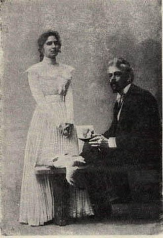 """Moscow Art Theatre production of The Seagull - Studio portrait of Stanislavski (right) as Trigorin—""""elegantly coiffured, clad in evening dress, mournfully contemplating the middle distance with pencil and notepad, suggests someone licked his chin on resurrecting the dead seagull in deathless prose than plotting the casual seduction of the ardent female by his side."""""""