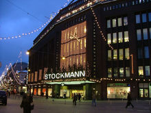 The flagship store of Stockmann in the centre of Helsinki. Photographed at dawn in December 2004, with Christmas lights and decorations.
