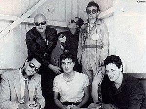 Luca Prodan - Argentine rock band, Sumo during a photo session (1985). (Up): Luca Prodan, Germán Daffunchio, Alberto Troglio. (down): Roberto Pettinato, Diego Arnedo and Ricardo Mollo.