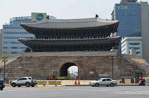 YTN - Original YTN tower (right background) with Namdaemun in the foreground, looking through open doors at the back of gate