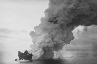 Surtsey - Surtsey's ash column rises over the newly forming island