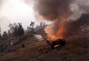 Battle of Jezzine (1982) - A destroyed Syrian T-62 Tank burning on the road outside of Jezzine