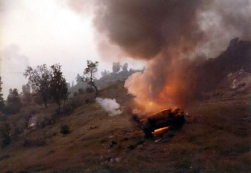 A Syrian tank burning on the road outside Jezzine Syrian Tank burning in Tzuk Track.jpg