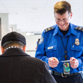 TSA Officer Checking ID.png