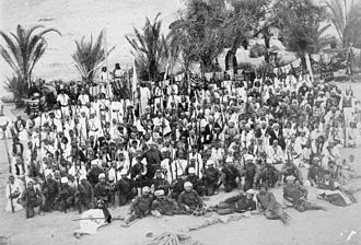 Arab cinema - T E Lawrence and the Arab Revolt 1916-1918, a scene (probably a set piece for cinema representation), showing a crowd of soldiers, both local and Indian, at Wejh, a port on the Red Sea coast north of Yenbo, 1913 (First World War, Pre-1914)