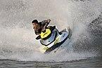 Teenager riding a jetski splashing on the Mekong.jpg