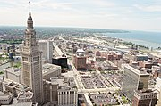 The Terminal Tower complex, with the Warehouse District, the Cuyahoga River, and Lake Erie in the background