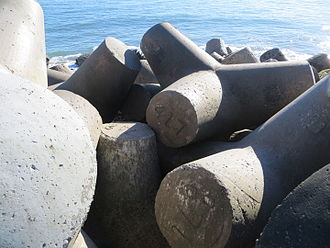 Tetrapod (structure) - Tetrapods protect the breakwater leading to the Walton Lighthouse at the entrance to the Santa Cruz Harbor in California, USA.