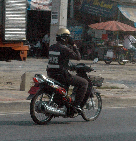 Image:Thai Policeman on Motorbike with Cellphone - Pattaya Thailand.jpg