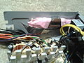 The 2nd power supply- sticking the resistors and their wires inside the power supply.jpg