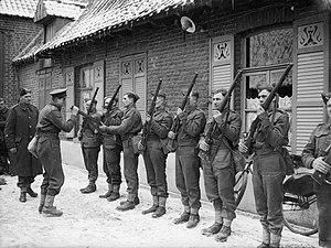 2nd Infantry Division (United Kingdom) - Rifle inspection for men of the 2nd Battalion, Dorset Regiment at Rumegies, France, 14 February 1940.