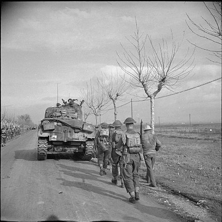 Guardsmen of the 1st Battalion, Irish Guards, advancing north of Anzio, Italy, 25 January 1944. The British Army in Italy 1944 NA11445.jpg
