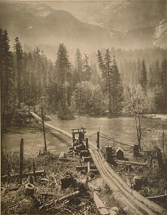 Skykomish River - Loggers' bridge on the Skykomish (1910).  Photo by Asahel Curtis.