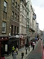 The Olde Cheshire Cheese on Fleet Street and the clock of the old Daily Telegraph building.jpg