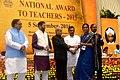 The President, Shri Pranab Mukherjee presenting the National Award for Teachers-2015 to Smt. Bhatt Madhuben Keshavlal (Gujarat), on the occasion of the 'Teachers Day', in New Delhi.jpg