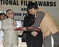 The President, Shri Pranab Mukherjee presenting the Rajat Kamal Award for Best Male Playback Singer Jaatishwar (Bengali) to Shri Rupankar, at the 61st National Film Awards function, in New Delhi on May 03, 2014.jpg