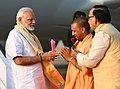 The Prime Minister, Shri Narendra Modi being welcomed by the Chief Minister of Uttar Pradesh, Yogi Adityanath, on his arrival, at Varanasi, Uttar Pradesh on September 17, 2018.JPG