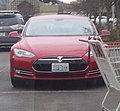 This is a picture of a Tesla Model S with a humorous license plate sayings ITS TYM (it's time) 2014-04-13 17-37.jpg