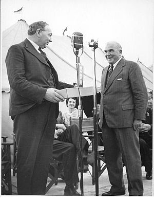 James Gordon Partridge Bisset - Bisset, right, presents a barometer to Thomas Playford at the opening of the Birkenhead Terminal, Port Adelaide, 29 September 1950