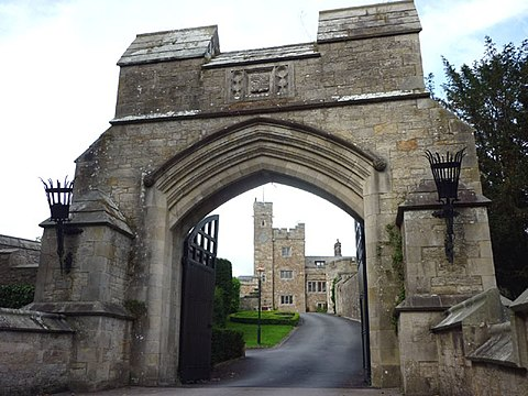 Thurland Castle seen though the arch of the gateway of the bridge crossing the moat Thurland Castle.jpg