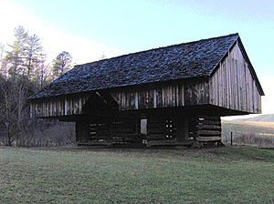 Crib barn - Double-cantilever, two-crib barn at the Tipton Place in Cades Cove, Great Smokey Mountain National Park, in East Tennessee. The cantilever barn design, which is Western European in origin, is common throughout Southern Appalachia but rare elsewhere in North America. National Register of Historic Places 77000111