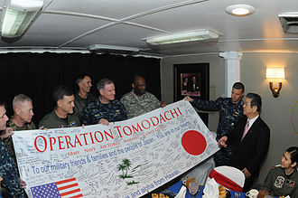 Toshimi Kitazawa is given an Operation Tomodachi banner on 4 April 2011 Toshimi Kitazawa receives an Operation Tomodachi banner.jpg
