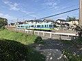 Train of Nishitetsu Kaizuka Line near Oishigaura Park.jpg