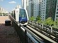 Train pulling into Cove LRT station.jpg