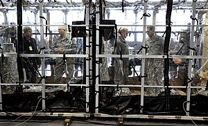 Defense Threat Reduction Agency - Members of the local area media and Scott Air Force Base medical personnel tour the Transport Isolation System January 23, 2015, during a roll-out ceremony for the system on Scott AFB, Illinois. (USTRANSCOM photo)