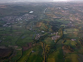Bar Hill Fort - Bar Hill as seen from the air looking east from Twechar towards the Firth of Forth along the line of the Forth and Clyde canal. Kilsyth is on the left and Cumbernauld is on the right. Castlehill has a similar aerial view to the west.