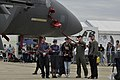 U.S. Air Force Capt. Christopher York, second from right, an F-15E Strike Eagle pilot with the 492nd Fighter Squadron, explains the capabilities of his aircraft to visitors during the Farnborough International 120715-F-RP755-058.jpg