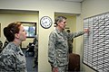 U.S. Air Force Capt. Michelle Clark, left, the chief of military justice with the Kadena Legal Office, explains an incident board to Lt. Gen. Richard Harding, the judge advocate general, March 29, 2013, during 130329-F-MU239-015.jpg