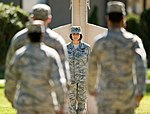 U.S. Air Force Master Sgt. Jeanette Spain, background center, with the 436th Airlift Wing, stands watch during a ceremonial vigil in observation of National POW-MIA Remembrance Day on Dover Air Force Base, Del 120921-F-BO262-036.jpg