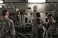 U.S. Air Force Tech Sgt. Angel Delacruz of Lichfield Park, Ariz., points out the equipment available to help care for a casualty aboard a C-17 Globemaster III cargo plane to Soldiers with the 801st Combat 130319-A-VX503-347.jpg