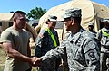 U.S. Army Brig. Gen. Clarence K. K. Chinn, right, the commanding general of the Joint Readiness Training Center and Fort Polk, La., greets Spc. Walter Cain, a medic with 550th Area Support Medical Company 120801-A-IA524-657.jpg