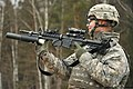 U.S. Army Sgt. Drew Garver, assigned to the 615th Military Police (MP) Company, 18th MP Brigade, loads a 40mm practice round into an M203 grenade launcher at the 7th Army Joint Multinational Training Command's 140116-A-BS310-120.jpg
