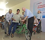U.S. Congressional delegation attends a wheelchairs and hearing aids distribution event in Danang (13941341612).jpg